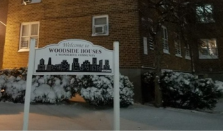 Woodside Houses welcome sign